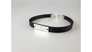 Silver bracelet made of rubber on rivets